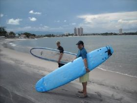 Two surfers on the beach in Coronado Panama – Best Places In The World To Retire – International Living
